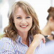 Mid age businesswoman in meeting — Stock Photo #11883741