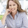 Successful mid age businesswoman on phone — Stock Photo