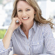 Successful mid age businesswomon phone — Stock Photo #11883841