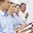 Group watching business presentation — Stock Photo #11883847
