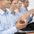 Foto Stock: Group applauding business presentation