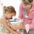 Female doctor examining child — Stock Photo #11883872
