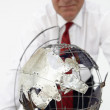 Senior businessman with globe — Stok fotoğraf #11883953