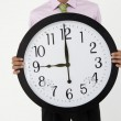 Young businessmwith giant clock — Stock Photo #11883997