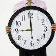 Foto de Stock  : Young businessmwith giant clock