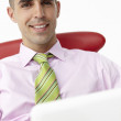 Young businessman using laptop — Stock Photo #11884013