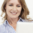 Mid age businesswoman using laptop — Stock Photo #11884023