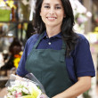 Hispanic woman working in florist - Stok fotoğraf