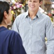 Man serving customer in florist — Stock Photo #11884131
