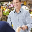 Royalty-Free Stock Photo: Man serving customer in florist