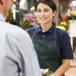 Woman serving customer in florist — Stock Photo #11884134