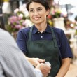 Woman serving customer in florist — Stock Photo