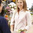 Woman shopping in florist — Stock Photo #11884139