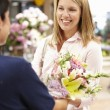 Woman shopping in florist - ストック写真