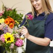 Woman working in florist — Stock Photo #11884145