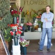 Man standing outside florist - Stock Photo