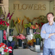 Man standing outside florist — Stock Photo