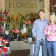 Couple standing outside florist - Stock Photo