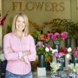 Woman standing outside florist - Stock Photo