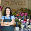 Woman standing outside florist - Stockfoto