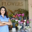 Woman standing outside florist — Foto de Stock