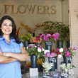 Woman standing outside florist — Stockfoto