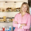 Woman working in hairdressing salon — Stock Photo