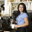 Woman working in coffee shop — Stok fotoğraf