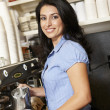 Stock Photo: Woman working in coffee shop