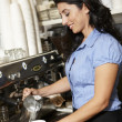 Woman working in coffee shop — Stock Photo