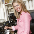 Woman working in coffee shop — Stock Photo #11884199