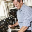 Stock Photo: Man working in coffee shop