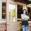Woman standing outside bakery - cafe - Stock Photo