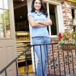 Woman standing outside bakery - cafe — Stock Photo