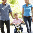 Parents with boy on bike — Stock Photo #11884280