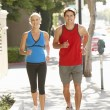 Couple running on city street — Stock Photo #11884291