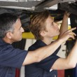 Mechanics at work — Stockfoto