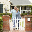 Senior Hispanic couple outside home - Stock Photo