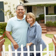 Senior Hispanic couple outside home — Stock Photo #11884427