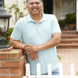 Senior Hispanic man outside home - Stock Photo