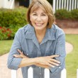 Senior Hispanic womoutside home — Stock Photo #11884437