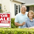 Senior Hispanic couple selling house - Stock Photo