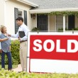 Senior Hispanic couple buying new home — Stock Photo #11884443