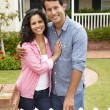 Stock Photo: Hispanic couple outside home