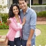 Hispanic couple outside home — Stock Photo #11884467