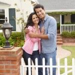 Hispanic couple outside home — Stock Photo #11884468