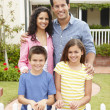 Hispanic family outside home — Stock Photo #11884473