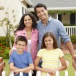 Stock Photo: Hispanic family outside home