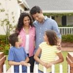 Hispanic family outside home — Stock Photo