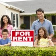 Stock Photo: Hispanic family outside home for rent